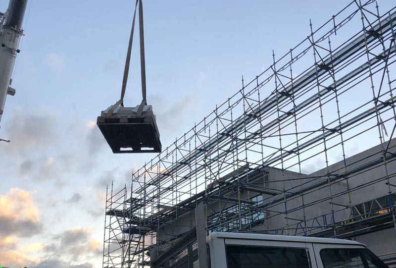 Moving the stone planter with a crane