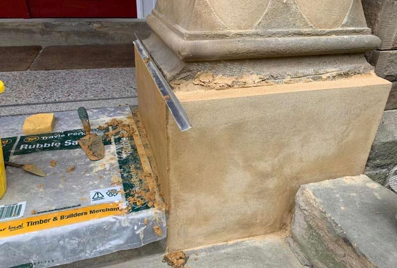Stone column mortar repair in progress